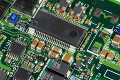 Printed circuit board. A close up image of a printed circuit or prited wire board with multi-pin ICs stock images