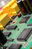 Printed Circuit Board. With various electronics devices assembled on it royalty free stock photos