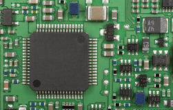 Printed-circuit board. The modern printed-circuit board with electronic components. Super macro background.  Logos and trademarks removed Stock Images