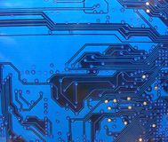 Printed circuit board. Fragment of blue circuit board stock photography