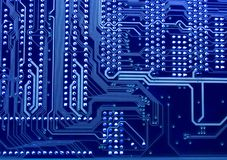 Printed circuit board in blue 2. On the picture is printed circuit board on the blue background Stock Photos