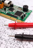 Printed circuit board and cable of multimeter on diagram of electronics Royalty Free Stock Image