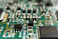 Printed circuit Board with chips and radio components electronics. Engineering industry technology equipment microchip pcb repair device integrated stock images