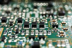 Printed circuit Board with chips and radio components electronics. Engineering industry technology equipment microchip pcb repair device integrated royalty free stock photos