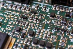 Printed circuit Board with chips and radio components electronics. Engineering industry technology equipment microchip pcb repair device integrated stock photo
