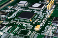 Printed Circuit board from a computer in black with green lines.  Royalty Free Stock Photography