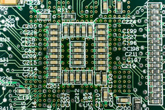 Printed Circuit board from a computer in black with green lines.  Royalty Free Stock Photos