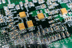 Printed Circuit board from a computer in black with green lines.  Royalty Free Stock Photo