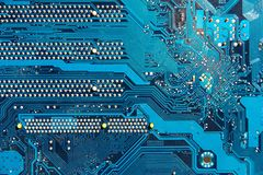 Printed circuit board. Detail of blue printed circuit board with silver studs stock images