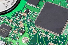Printed circuit board with different processors. Printed green circuit board with different processors, microcomputers, controllers and chips royalty free stock photos