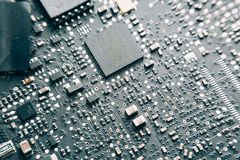 Printed Circuit Board with electrical components. Royalty Free Stock Image