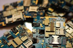 Many discarded circuit boards. Printed circuit board on a graphics card Royalty Free Stock Photo