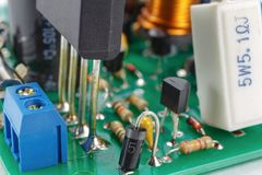 Printed circuit board with installed analogue electronic components closeup Stock Images