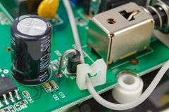 Printed circuit board with installed electronic components closeup Royalty Free Stock Photography