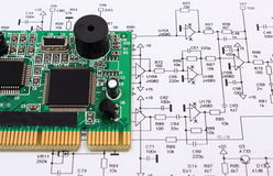 Printed circuit board lying on diagram of electronics, technology Stock Photo