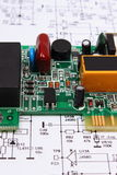 Printed circuit board lying on diagram of electronics, technology Stock Photography