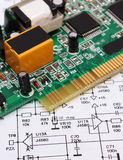 Printed circuit board lying on diagram of electronics, technology Stock Image