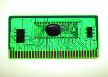 Printed circuit Board and memory chip green with the glowing background. White Stock Image