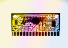 Printed circuit Board and memory chip green multicolored toning. White background Stock Image