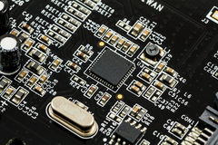 Printed Circuit Board (PCB) with, ICs, Capacitors, and Resistors Stock Photo