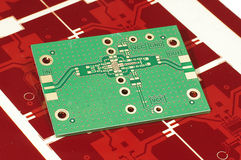 Printed circuit board PCB on red gerber mask for manufacturing Royalty Free Stock Image
