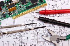 Printed circuit board. precision tools and cable of multimeter on diagram of electronics Royalty Free Stock Images