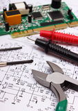 Printed circuit board. precision tools and cable of multimeter on diagram of electronics Stock Photo