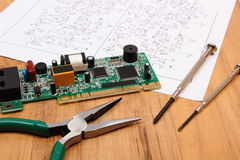 Printed circuit board. precision tools and diagram of electronics, technology Stock Photo