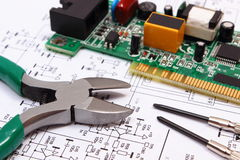 Printed circuit board and precision tools on diagram of electronics, technology Stock Image
