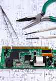 Printed circuit board and precision tools on diagram of electronics, technology Stock Photo