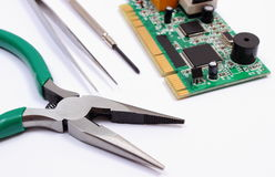 Printed circuit board and precision tools on white background, technology Royalty Free Stock Photo