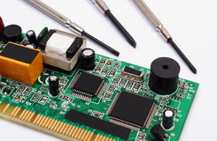 Printed circuit board and precision tools on white background, technology Royalty Free Stock Images