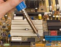 Printed circuit board repair work Stock Image