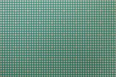 Printed circuit board, seamless pattern background texture. Printed circuit board, many holes, seamless pattern background texture Stock Image