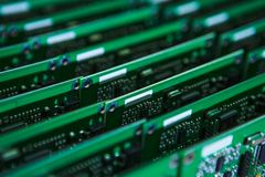 Printed Circuit Boards with Lots of Surface Mounted Components. Modern Electronics Ideas. Closeup of Lot of Electronic Printed Circuit Boards with Lots of Royalty Free Stock Image
