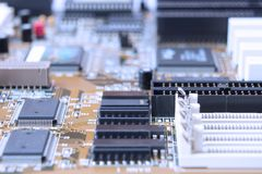 Printed circuit motherboard with slots. On board are capacitors resistors, slots, integrated circuits, microprocessor Stock Photography