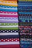 Printed colored fabrics. Background, vertical Stock Photos