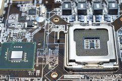 Printed computer motherboard with microcircuit, close up stock photography