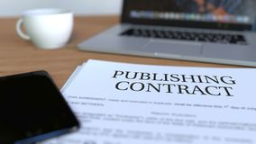 Copy of publishing contract on the desk. 3D rendering. Printed copy of contract on the desk Stock Photos
