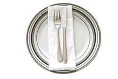 Printed dinner Plate. Place Setting with striped printed dinner plate, cutlery and serviette isolated on a white background Stock Photos