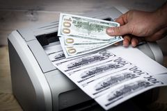 Printed dollars. home printer. concept, crime, fake money. Printed dollars. home printer. concept crime fake money stock photography