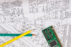 Printed drawings of electrical circuits, electronic board and pencils. Science, technology and electronics. stock image