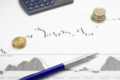 Printed forex growing chart with money profit. Forex growing chart on white paper with multiplied coins are showing profit on a stock market Royalty Free Stock Image