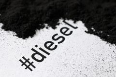 Printed hashtag diesel with soot and soot pile stock images