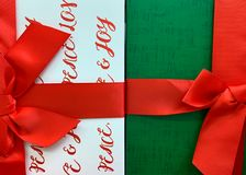 Two Christmas gift boxes with red ribbons and bows royalty free stock photo