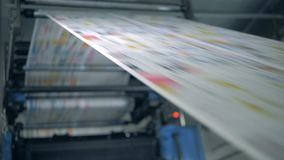 Printed newspaper on a typographic line, modern equipment. 4K stock video