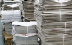 Printed newspapers pile Stock Image