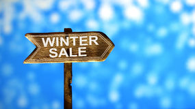 Printed old paint text winter sale, on wooden arrows road sign. Royalty Free Stock Photos