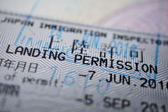 Printed passport stamp with a caption Landing permission stock photo