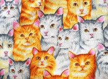 Printed pattern of cute kittens on fabric Royalty Free Stock Photo